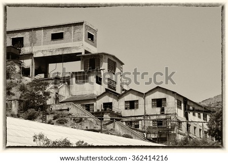 Old buildings of an abandoned mine in Sardinia, Guspini, Montevecchio - stock photo
