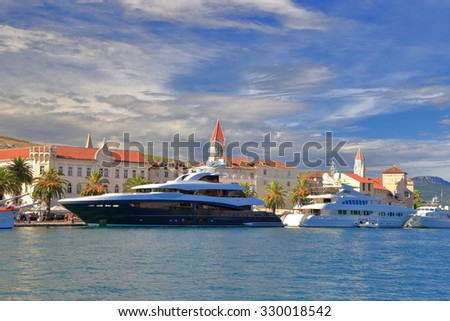 Old buildings of Venetian town and luxury yachts near the shore, Trogir, Croatia - stock photo