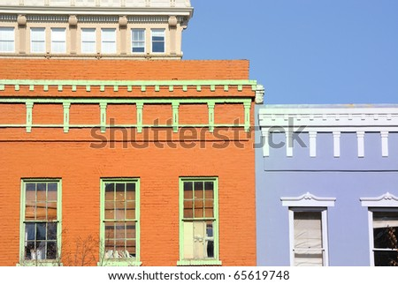 Old buildings with vivid paint. - stock photo