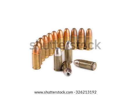 Old bullets over white background