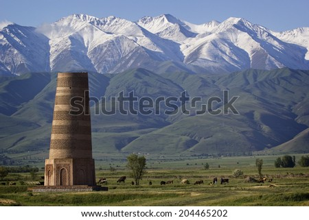 Old Burana tower located on famous Silk road, Kyrgyzstan. - stock photo