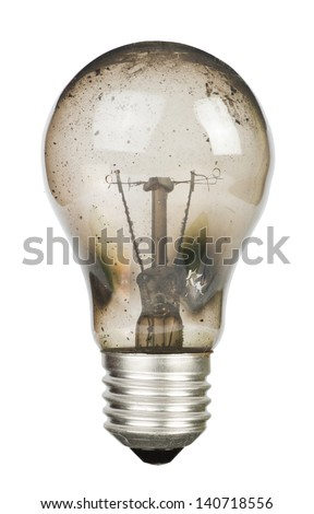 Old burnt lamp smoked inside. White isolated - stock photo
