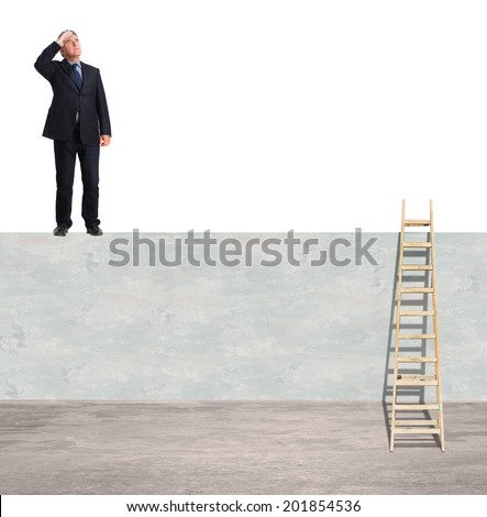 old businessman looking for on a wall - stock photo