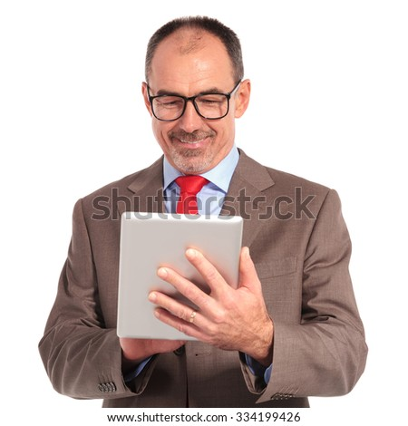 old businessman working on his tablet computer on white background