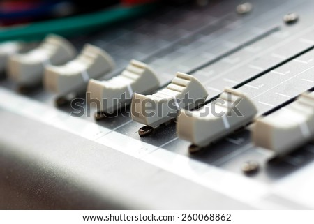 Old buttons equipment in audio Mixing Console - stock photo