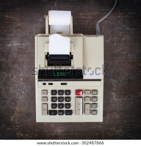 Old calculator showing a text on display - loan - stock photo