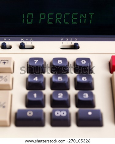 Old calculator with digital display showing a percentage - 10 percent - stock photo