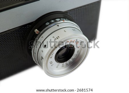 Old camera isolated on white background. Shallow depth of field.