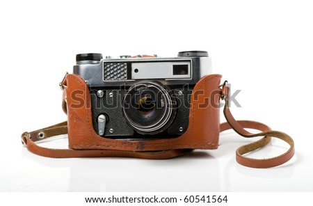 Old camera. Leather Case - stock photo