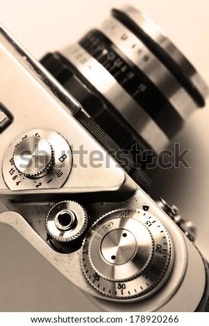 old camera. Sepia. Stylish retro background. - stock photo