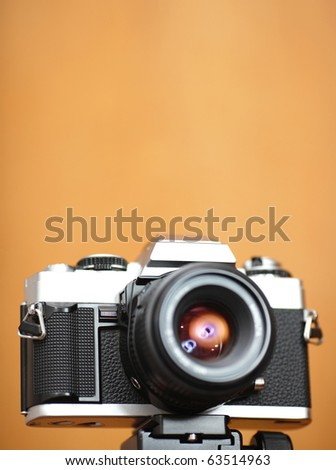 old camera with copyspace in shallow dof - stock photo