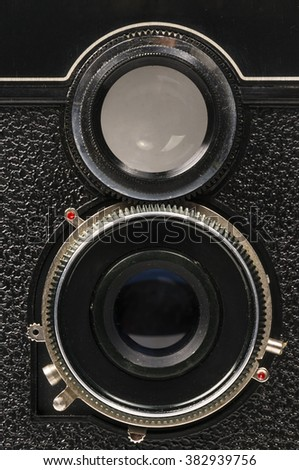 Old camera with two lenses (detail) - stock photo