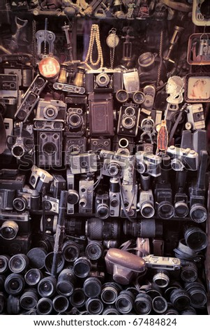 Old cameras in a marketplace - stock photo