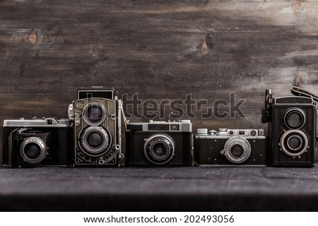 old cameras retouching Vintage - stock photo
