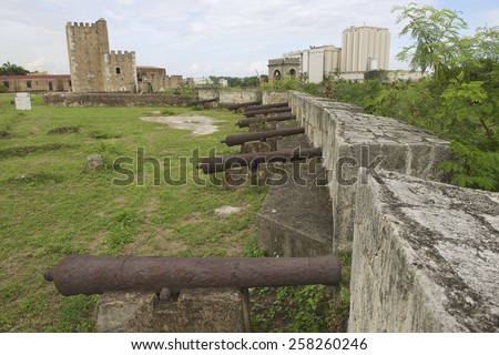 Old cannons at the fortress wall of Ozama Fortress in Santo Domingo, Dominican Republic. UNESCO World Heritage site. - stock photo