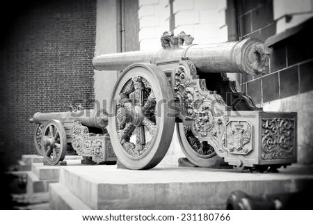 Old cannons shown in the Moscow Kremlin, a popular touristic landmark. UNESCO World Heritage Site. Black and white photo.