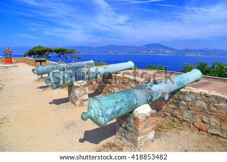 Old canons aligned on the walls of Saint Tropez fortress, French Riviera, France - stock photo