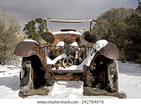 Old Car Abandoned in Desert Snow  - stock photo