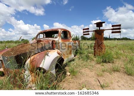 old car in the desert - stock photo