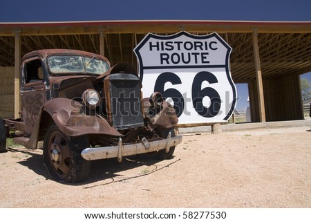 Old car in the famous route 66 road in USA - stock photo