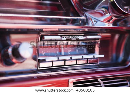 Old car radio in a classisc car - stock photo