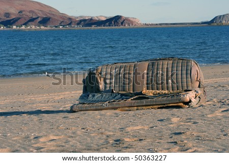 Old car seat on the beach of Gonzaga Bay in Baja California - stock photo