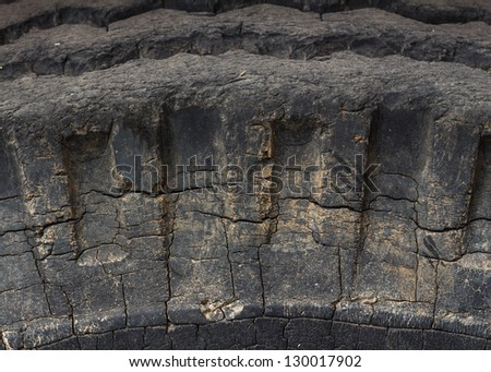 Old car tire texture - stock photo
