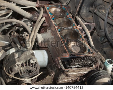 Old car with the engine disassembled for repair - stock photo