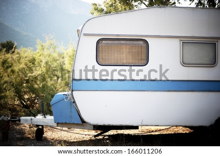 Old caravan parked in a campsite - stock photo