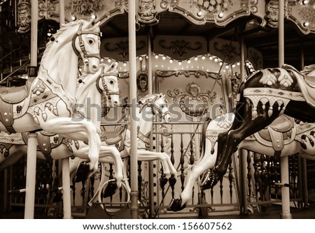 Old carousel horses. Paris. Sepia. Retro style postcard. - stock photo