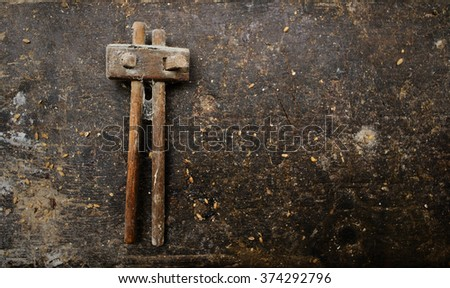 Old carpenter tool on dirty wooden table. Top view. flat lay - stock photo