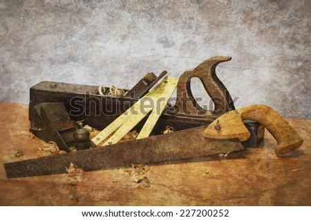 Old carpentry tools on a wooden table - stock photo
