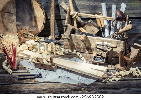 Old carpentry workshop with tools - stock photo