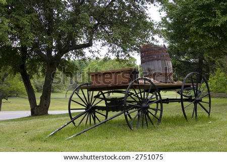 Old carriage in park setting.