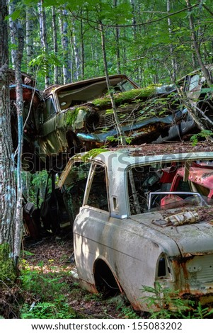 Old cars at a junkyard - stock photo