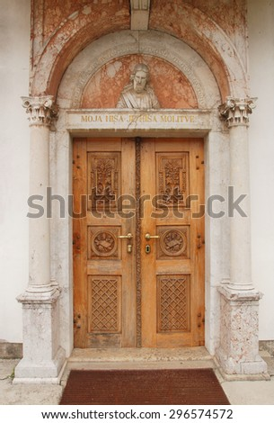 Old carved wooden church door Slovenia
