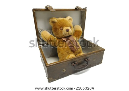 Old case with teddy bear isolated against a white background - stock photo