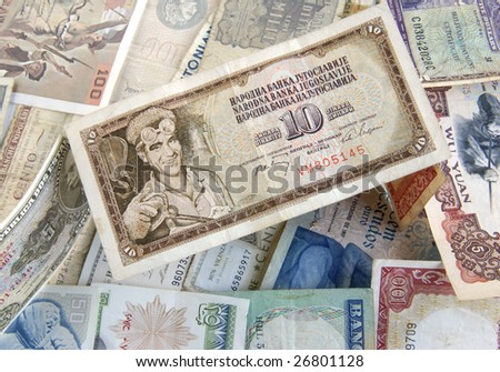 Old cash money from different countries around the world. With old Dinaras from Yugoslavia on top. - stock photo