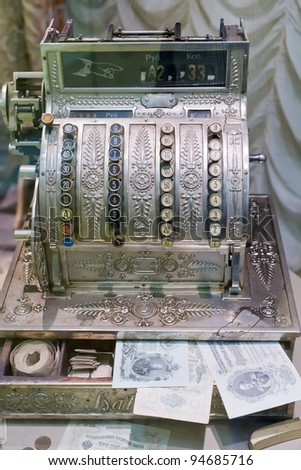 old cash register with old banknotes - stock photo