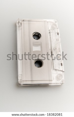 Old cassette over gray background