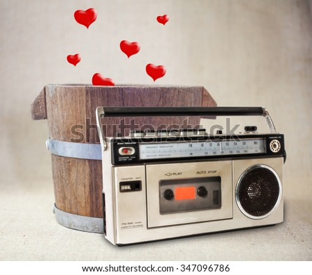 Old Cassette player and Hearts Drop in Wooden Bucket .