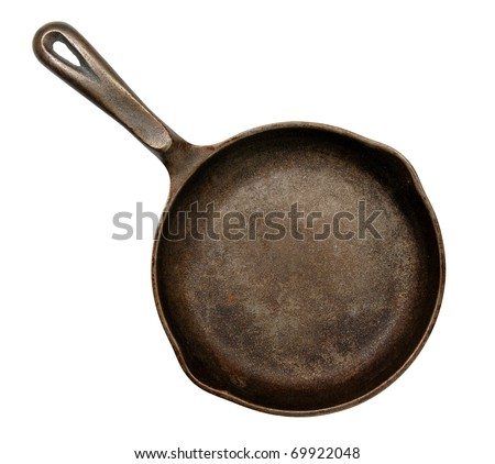 old cast iron frying pan, isolated on white - stock photo