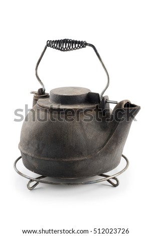 old cast iron kettle with grid support isolated on white