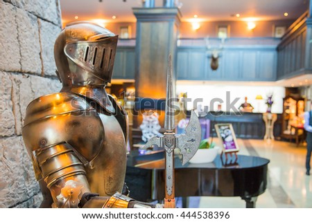 Old castle hotel reception interior with a guard armour at the entrance. - stock photo