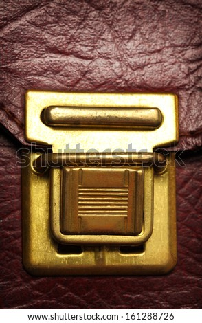 Old catch lock on leather suitcase
