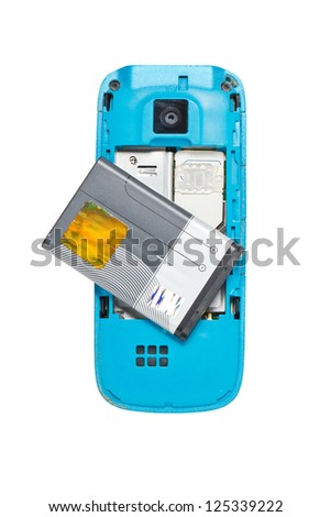 Old cellphone backside with battery. - stock photo