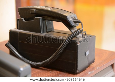 Old cellular mobile phone big and heavy - stock photo