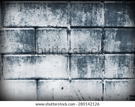 Old cement blocks wall imitation brick wall painted black-white color(monochrome) vintage for background. Crack paint looks scare, sad, dirty, formidable. - stock photo
