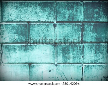 Old cement blocks wall imitation brick wall painted green color vintage for background. Crack paint looks scare, sad, dirty, formidable - stock photo