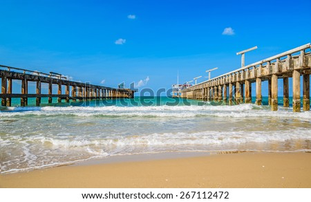 Old cement broken pier at the sea. - stock photo